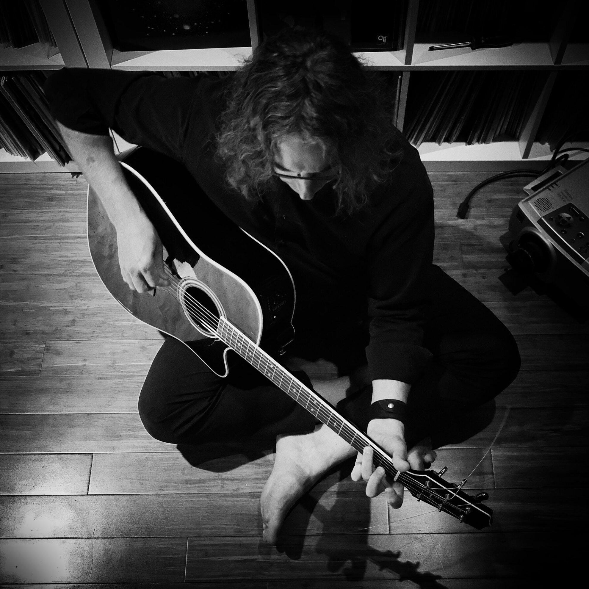 Tim Motzer with guitar